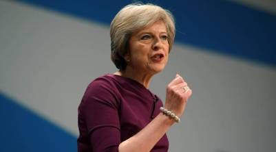 Britain's Prime Minister Theresa May gives her speech on the final day of the annual Conservative Party Conference in Birmingham